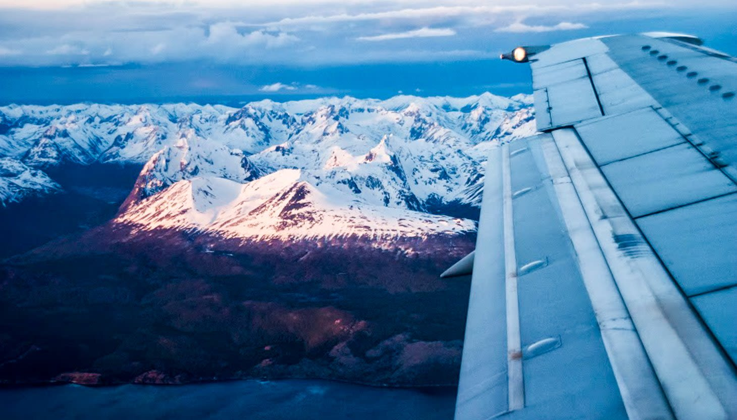 Airplane wing over Andes mountains near Ushaia, Argentina