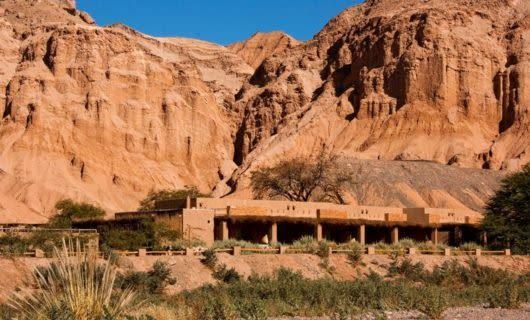 Alto Atacama Hotel against cliff