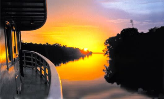 Sunset over deck of Amazon river cruise ship