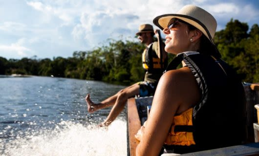 Tour group rides boat on Amazon river