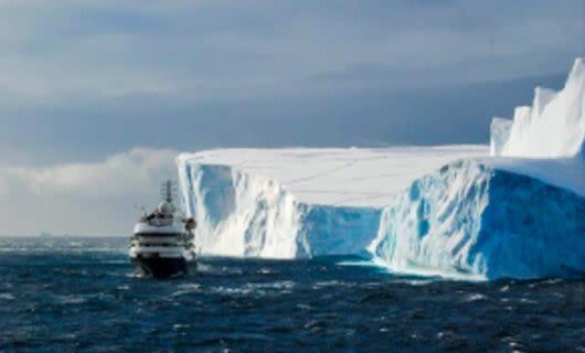 Antarctica cruise ship passes large glacier