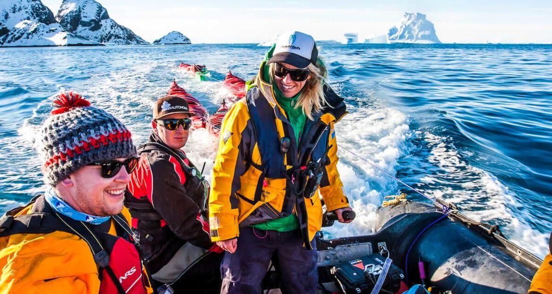 Antarctica travelers sit on motorized raft