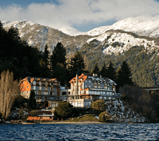 Exterior of mountain hotel with views of water