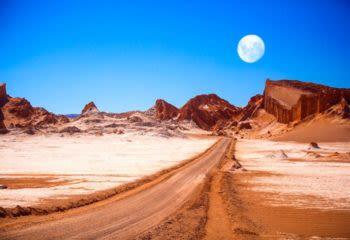 Full moon hangs over the Atacama Desert in Chile