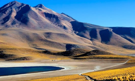 Atacama mountains with lake in front