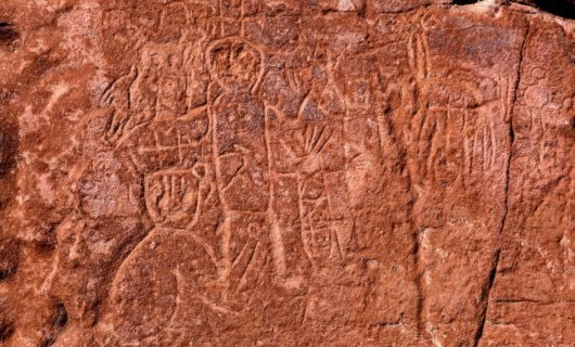 Markings and art on rock wall