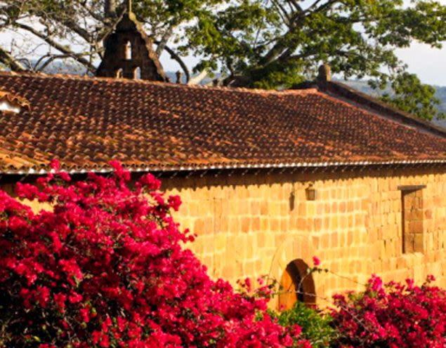Church in Barichara, Colombia with red flowers