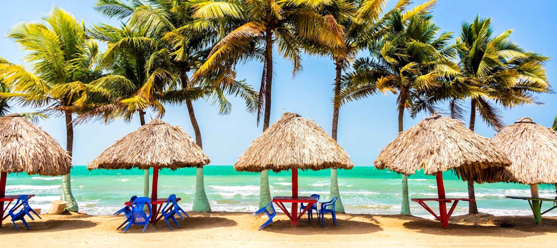 Colombia beach seating area with palm trees