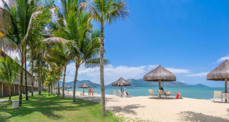 people-lounging-on-beautiful-sunny-beach-in-brazil-at-portobello-hotel
