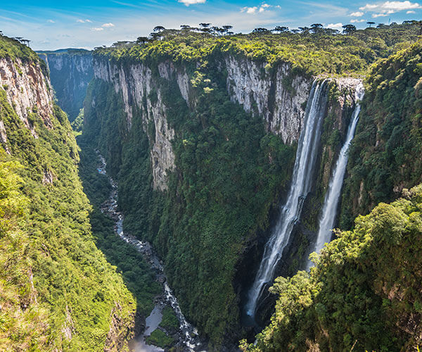 Stunning waterfall and mountain landscape on south america nature tour