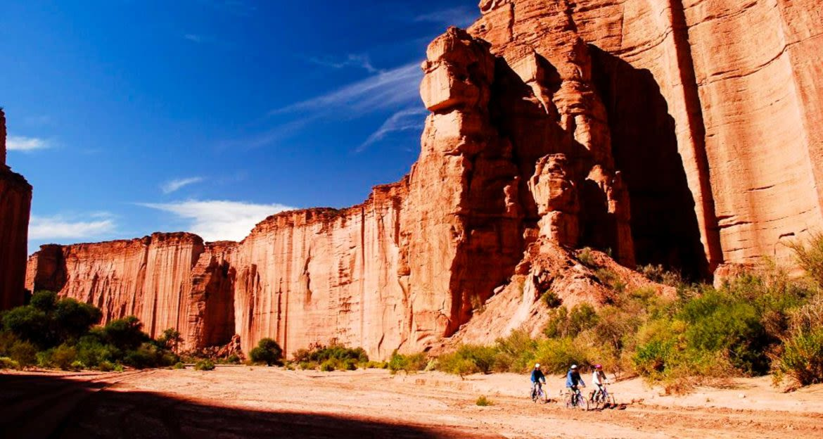 Group of bicycles ride through canyon