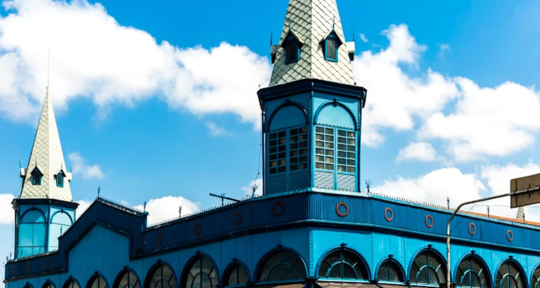 Spires of blue building against sky