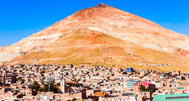 Mountain peak rises behind Bolivia town