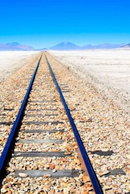 Train track across salt flats of Bolivia
