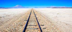 Train track across salt flats of Bolivia