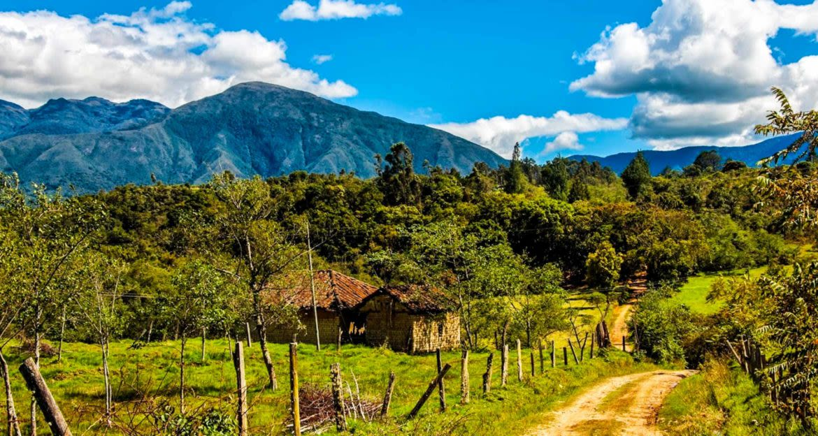 Dirt road winds through Boyaca countryside in Colombia