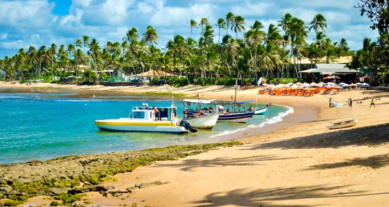 Boats on shore of Brazil beach