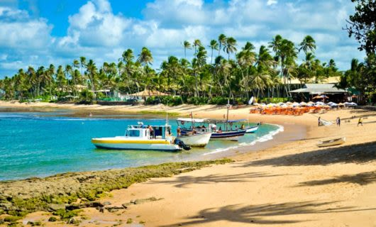 Boats on shore of Brazil beach