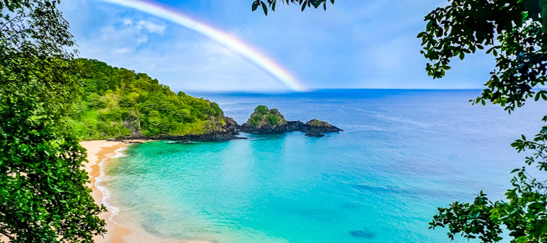 Rainbow over beach of Fernando de Noronha, Brazil