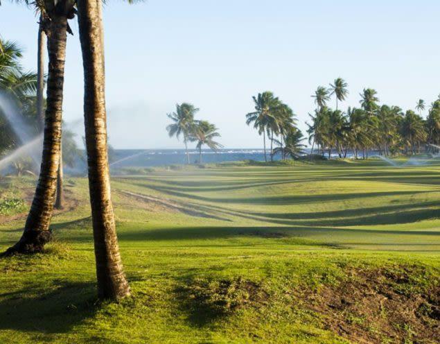 Sprinklers spray over Brazil golf green