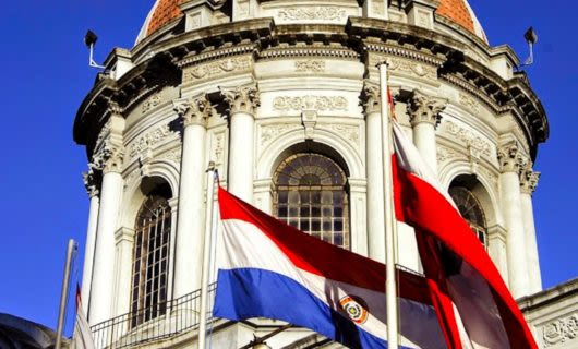 Paraguay flags in front of building