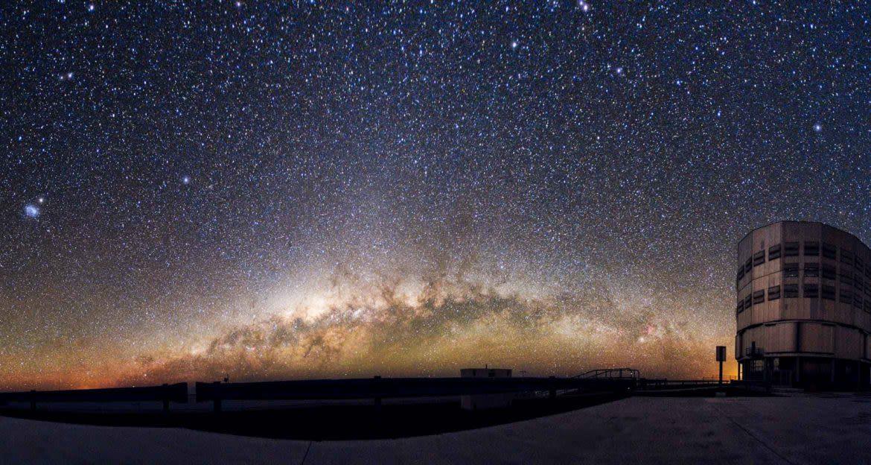 Building under vast starry sky