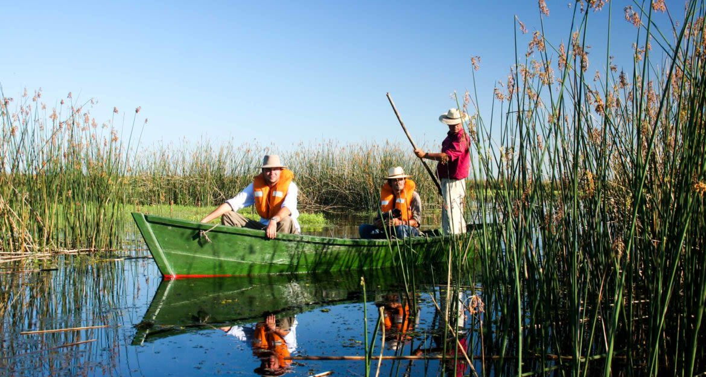 Travelers enjoy canoe ride through tall reeds