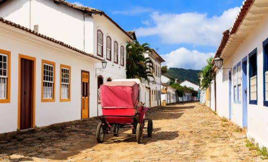 Carriage drives down cobbled Brazil street