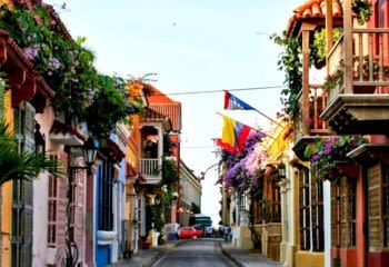 Walking down a colorful street in Cartagena on a tour of Colombia