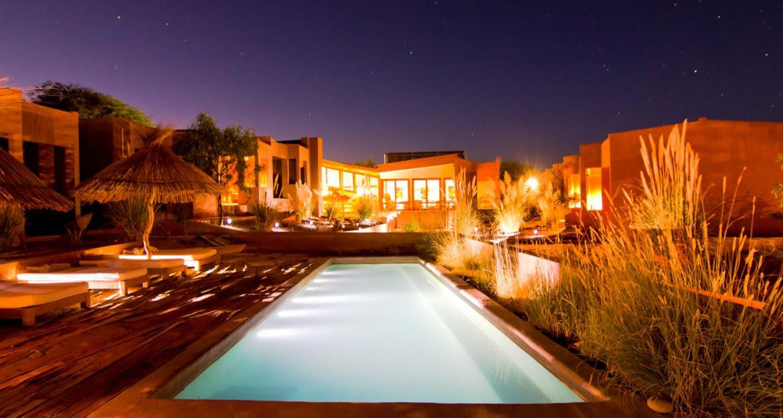 Outdoor pool area at Casa Atacama at night