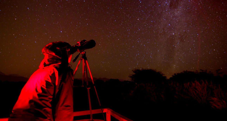 Person stargazing through telescope at Casa Atacama