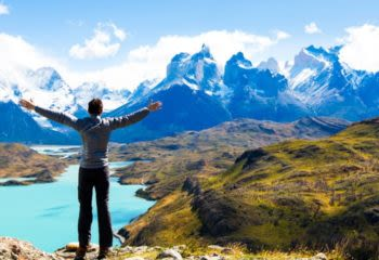 Hiker stands against Torres del Paine mountains