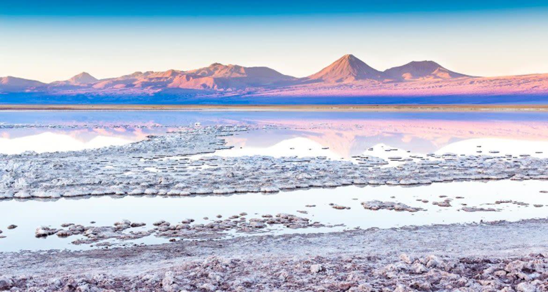 Mountains reflected in salt lake of Atacama, Chile