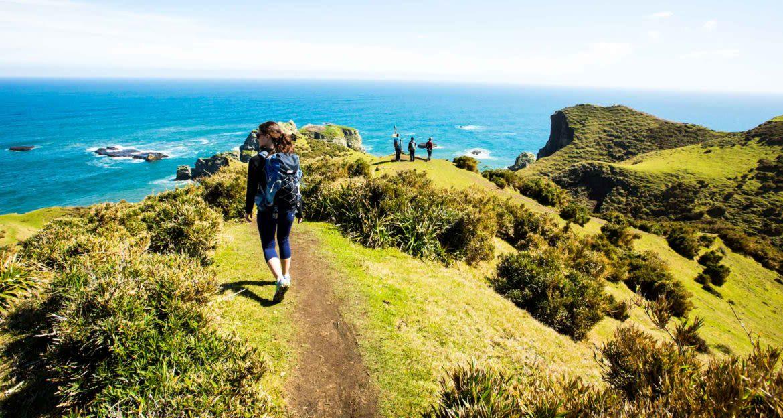 Hikers walk along coast of Chiloe Island