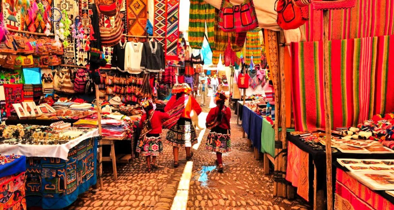 Woman walks through cloth market