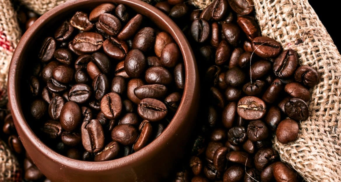 Close up coffee beans in a brown bowl