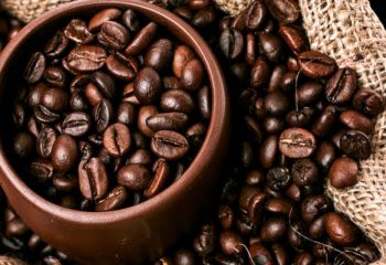 Close up of Colombian coffee beans in a brown bowl