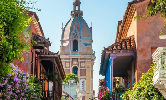 Spire of Colombia church seen past balconies of houses