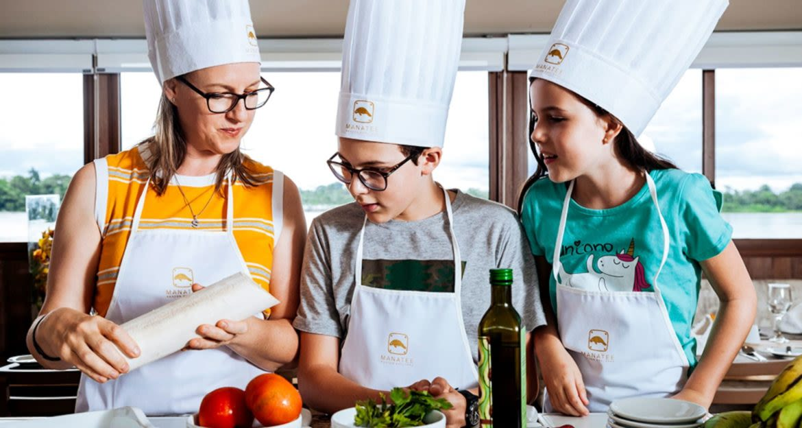People take cooking class on cruise ship