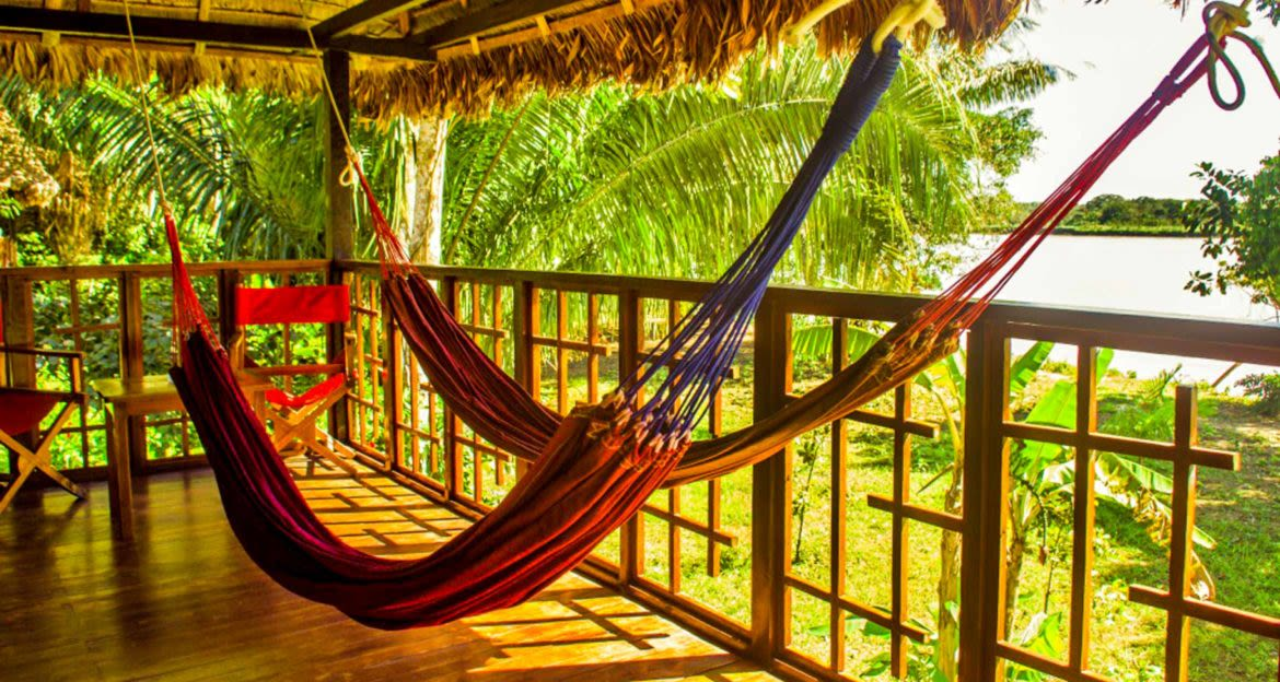 Two hammocks hang on deck of Corto Maltes Lodge