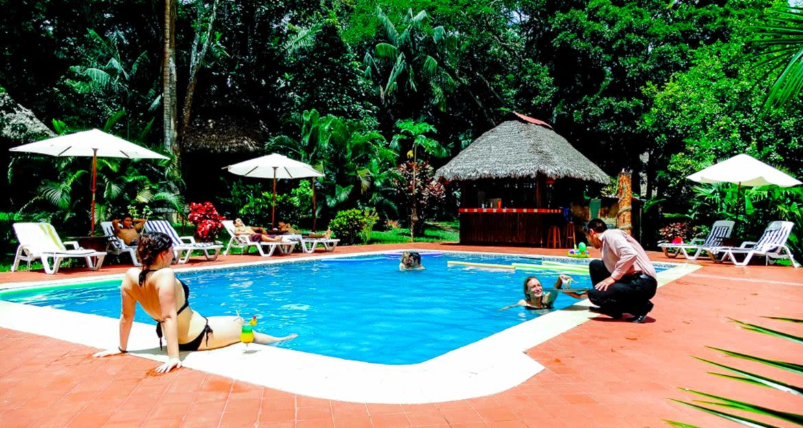 Travelers lounge around Corto Maltes outdoor pool