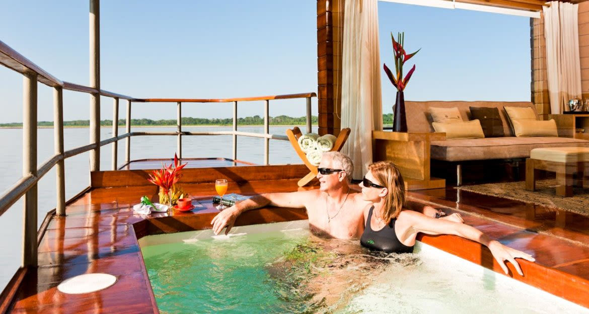 Couple lounges in hot tub on cruise ship