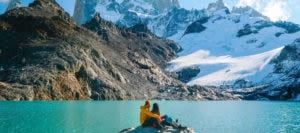couple in patagonia staring at mountains