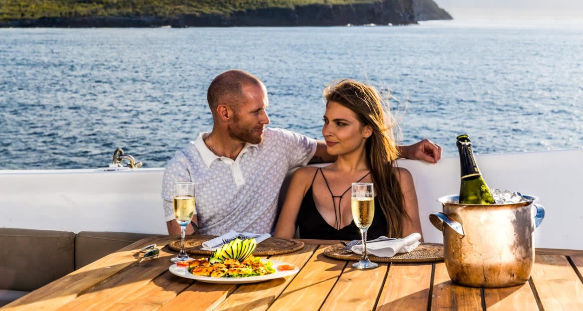 Couple enjoys meal on deck of cruise ship