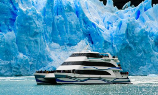 Cruise ship moves past glaciers