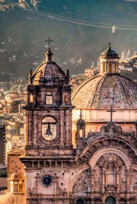 Large cathedral building and view over city center in valley of Cusco on a Cusco Tours