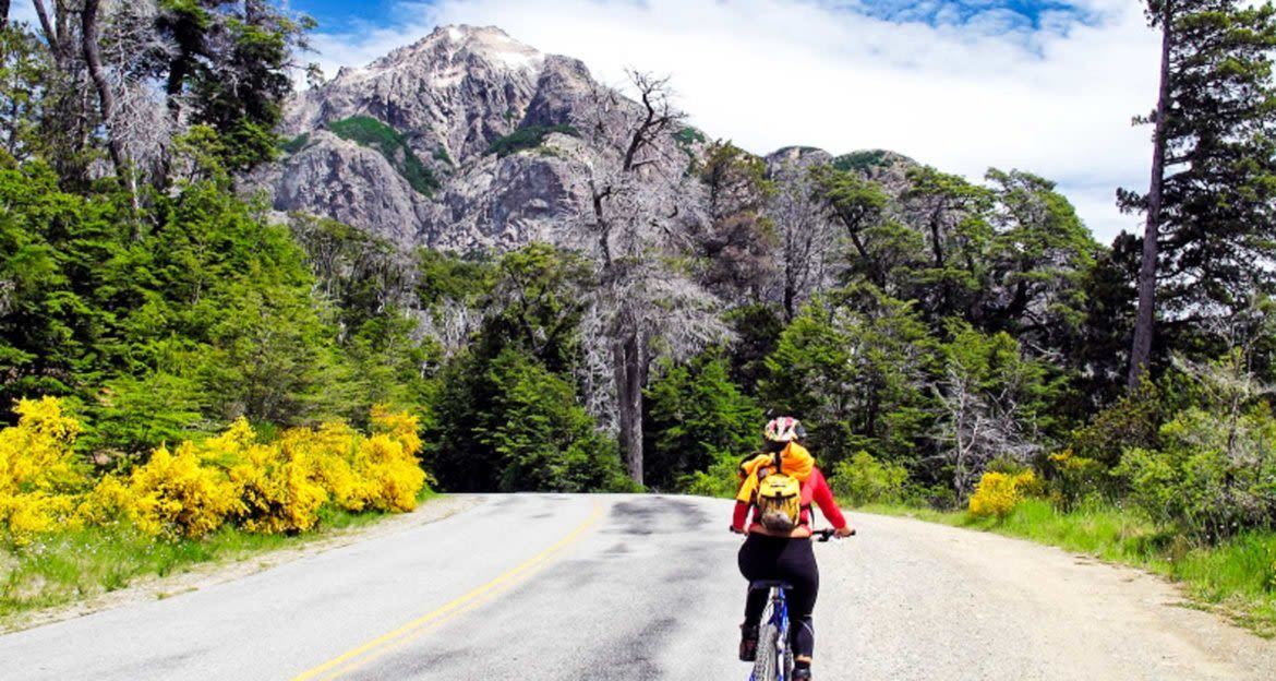 Cyclist rides down mountain road