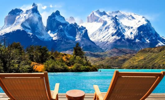 Chairs sit on deck with view of Patagonia mountains