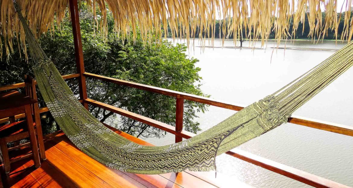 Hammock hangs on deck near river