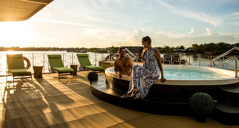 Travelers enjoy evening hot tub on Amazon cruise